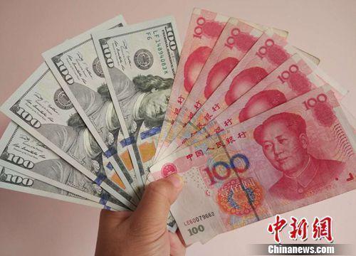 人民币对美元升破6.5 去年换2万美元现亏9000元