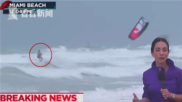美电视台直播飓风被抢镜 男子手拉风筝海中冲浪
