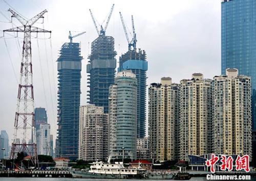 资料图:正在建设的楼盘。<a target='_blank' href='http://www.chinanews.com/'>中新社</a>记者张斌摄